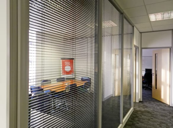 glass office partitions with blinds