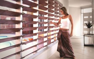 woman standing near beautiful louvre windows in Sydney