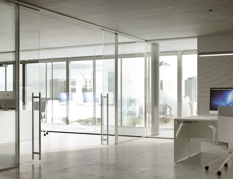 minimal office decor with frameless glass partitioning walls