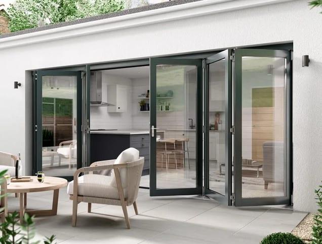 black framed aluminium and glass bifolding doors in patio