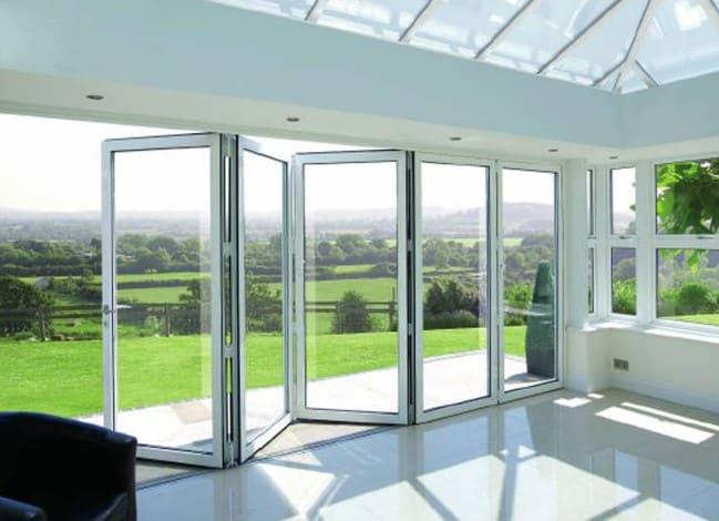 white aluminium framed bifold glass doors design