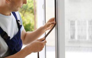 glass repair expert in sydney fixing a broken window